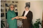 Joyce handing the original family bible over to Sister Bertrand